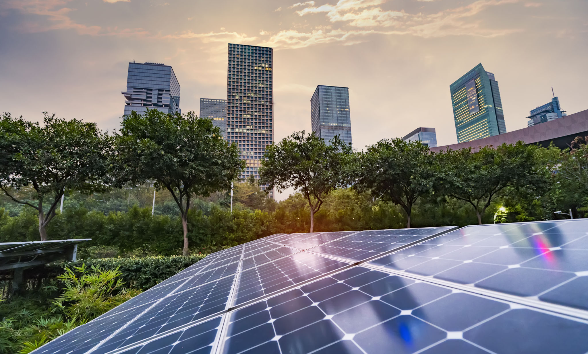 Cityscape with trees and solar panel -Nationally Determined Contribution or NDC